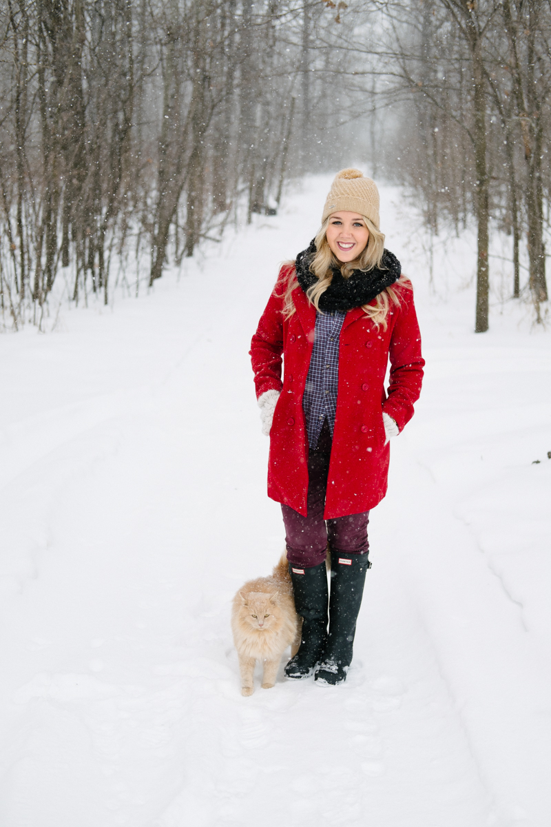 Debora Dahl wearing a red coat in the snow
