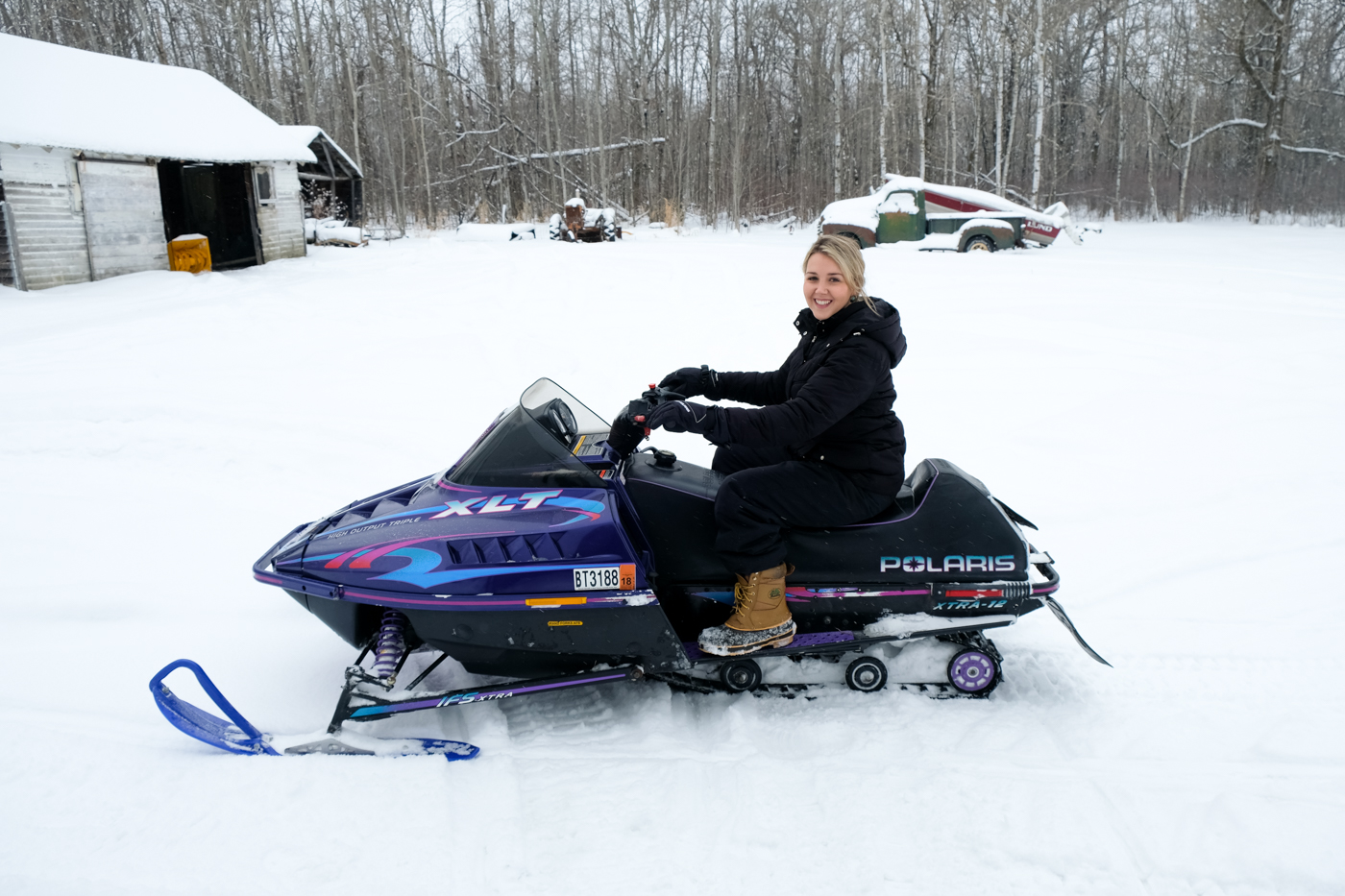 Debora Dahl playing in the snow in the snowmobile