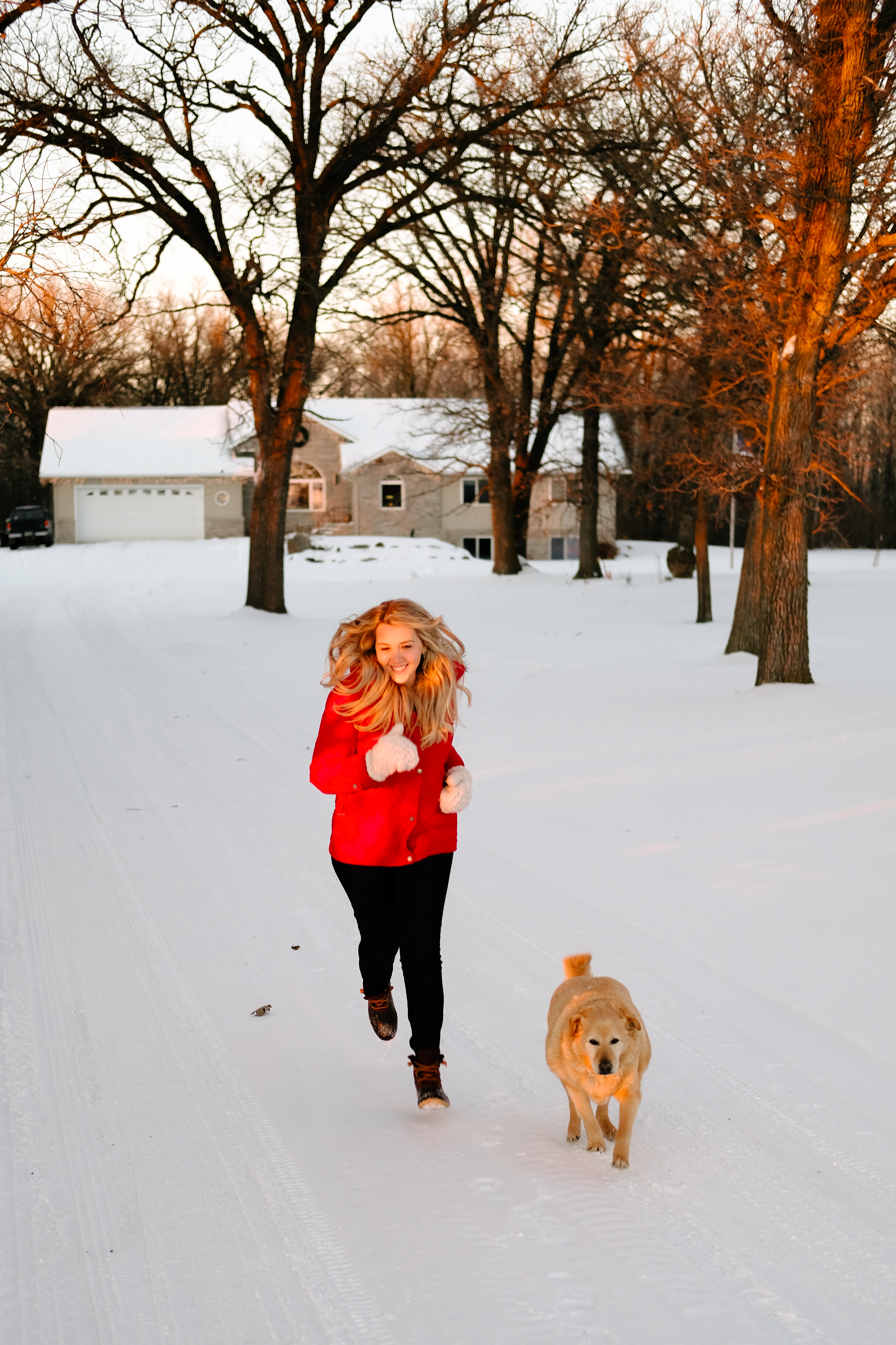 Debora Dahl running in the snow with a dog