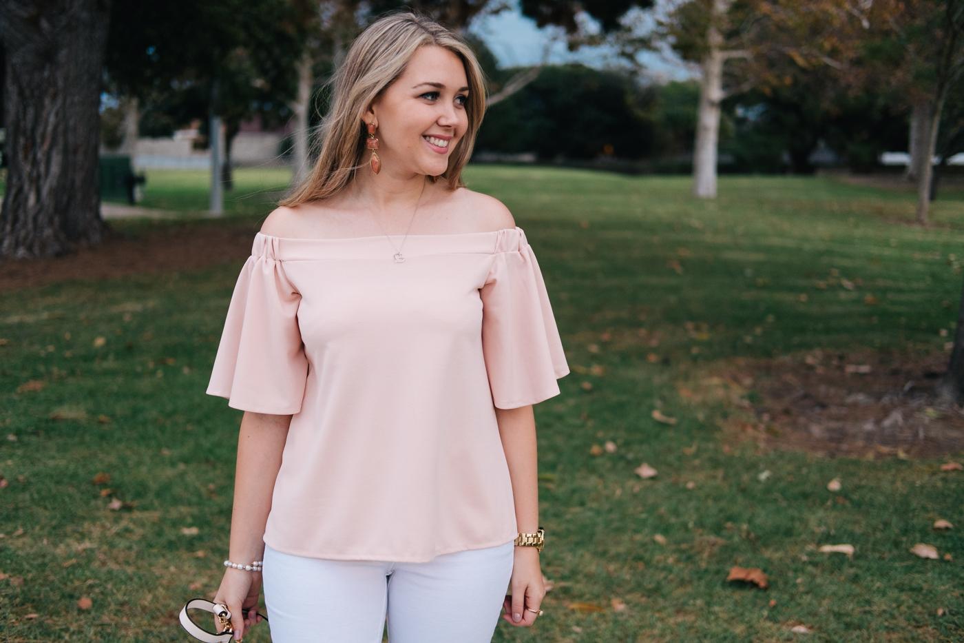 Debora Dahl wearing a pink off the shoulder white blouse from dresslily