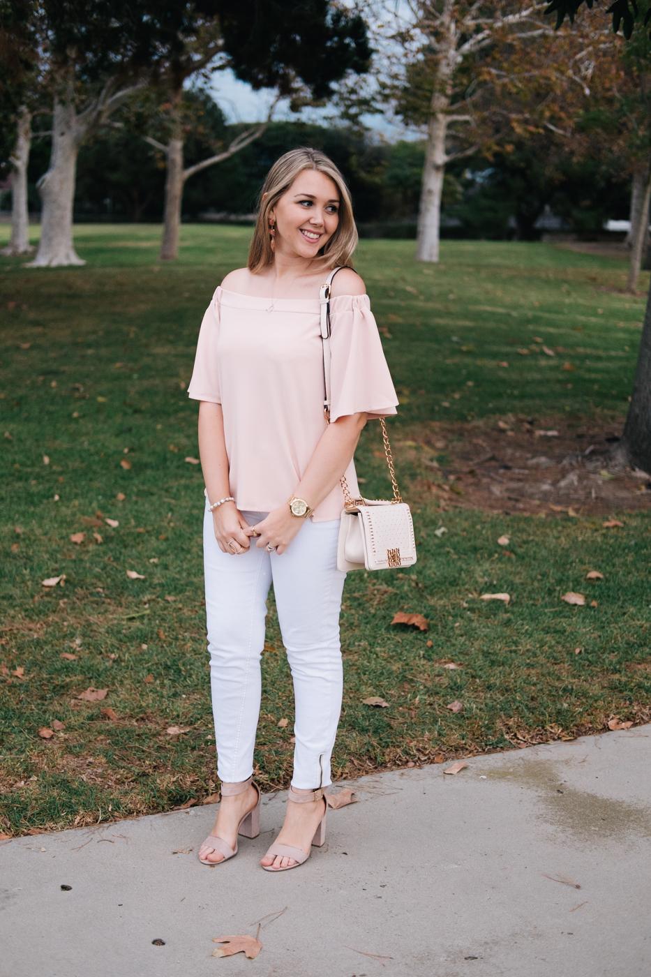 Debora Dahl wearing pink blouse and white pants