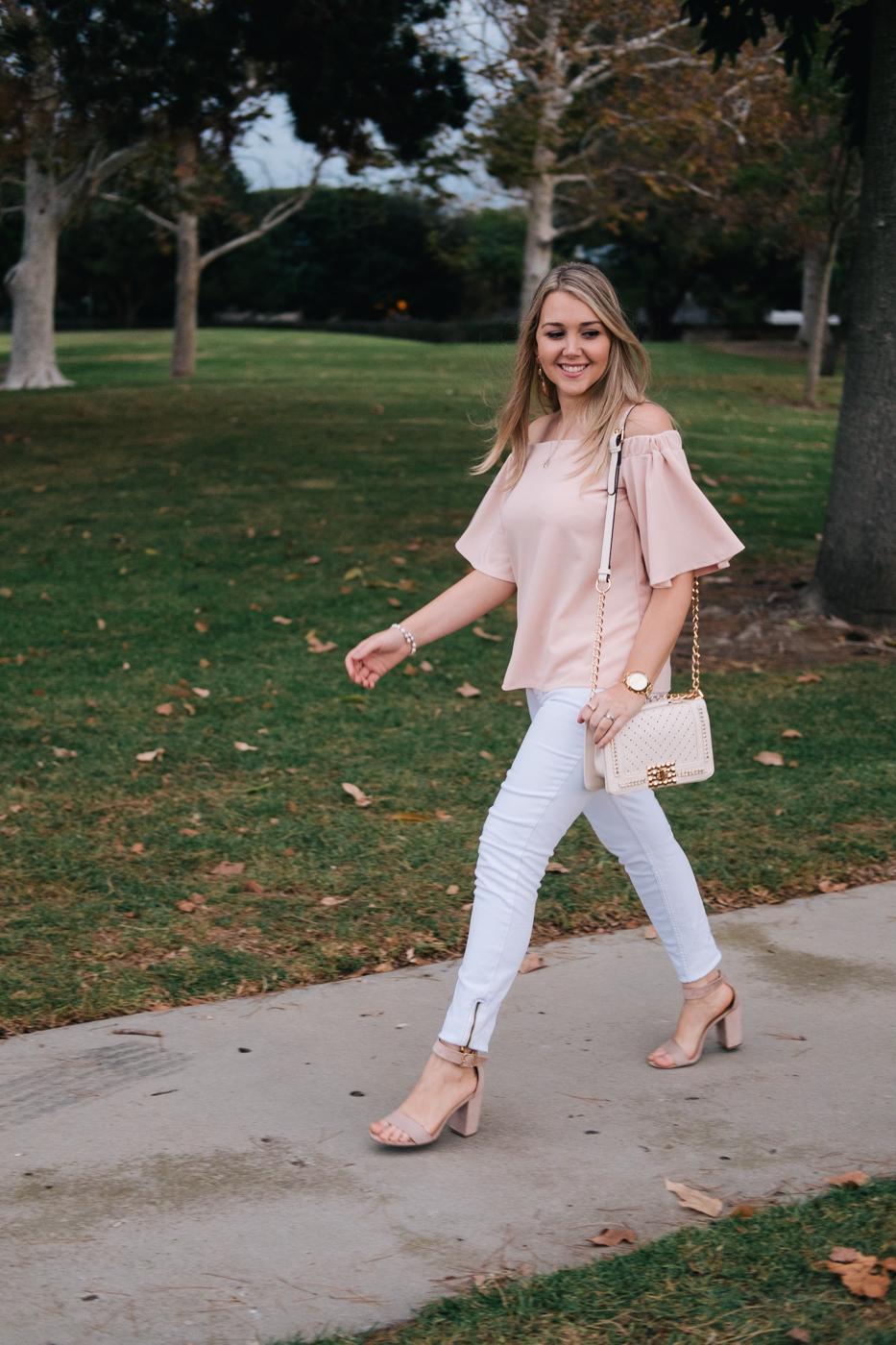 Debora Dahl walking with off the shoulder top