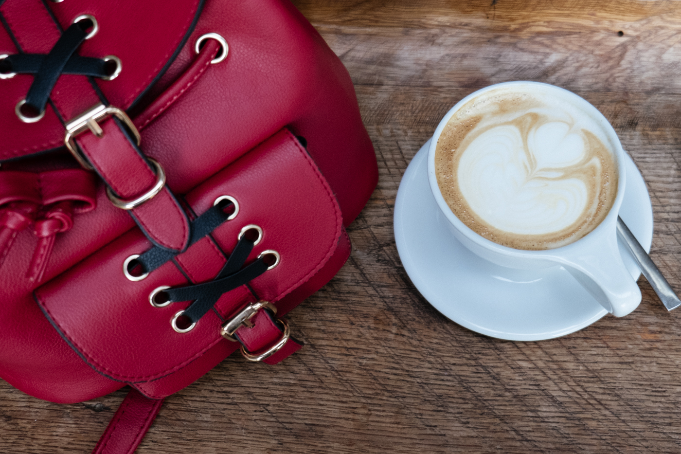 Coffee art and red backback from Debora Dahl