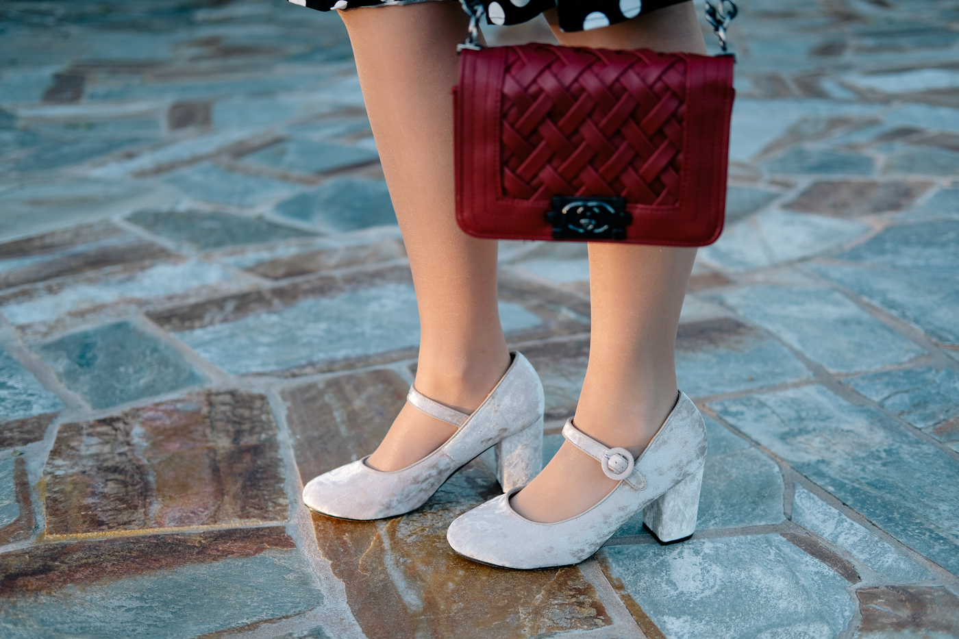 Velvet shoes and red purse