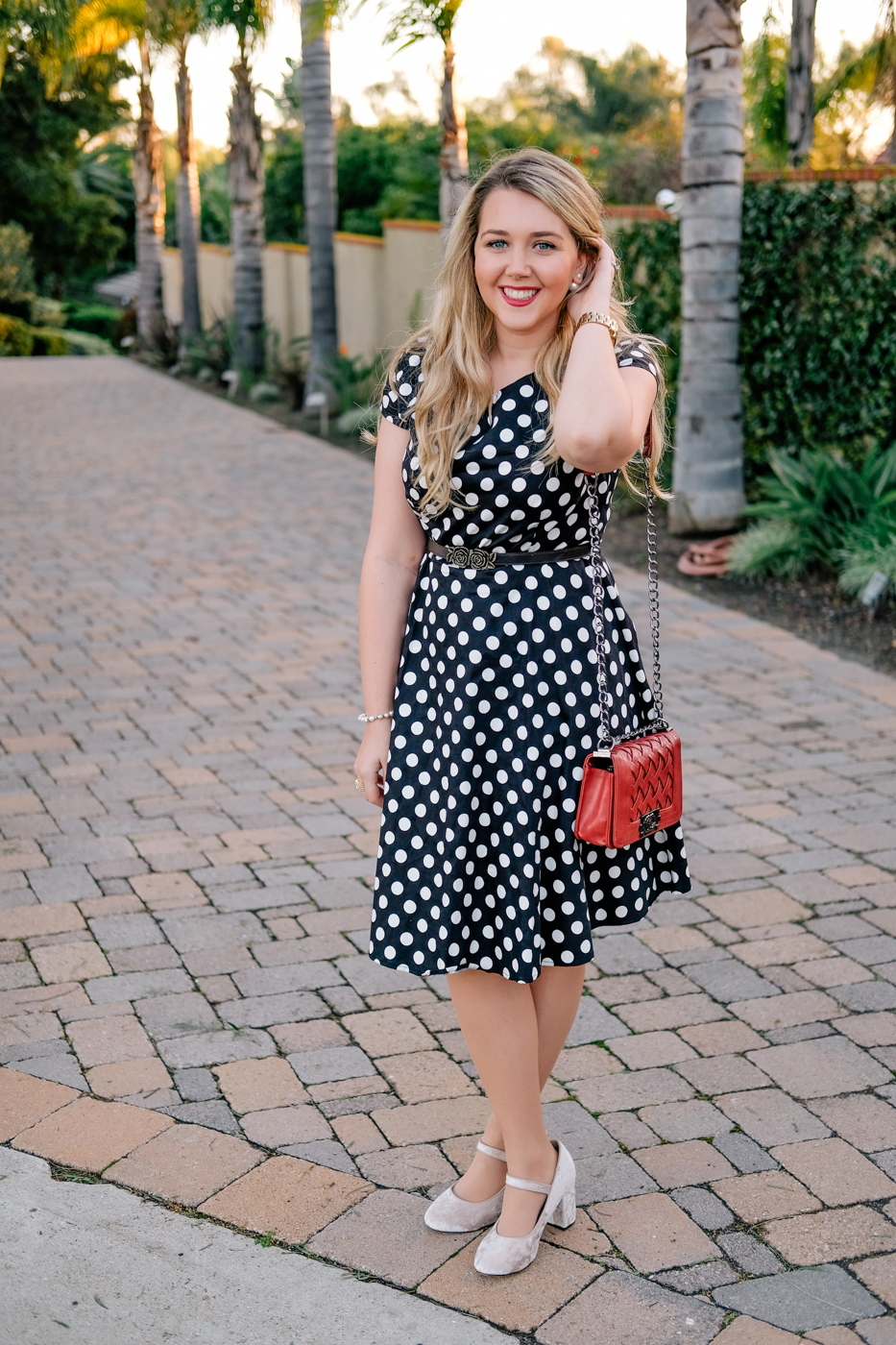 Debora Dahl black polka dor dress red purse