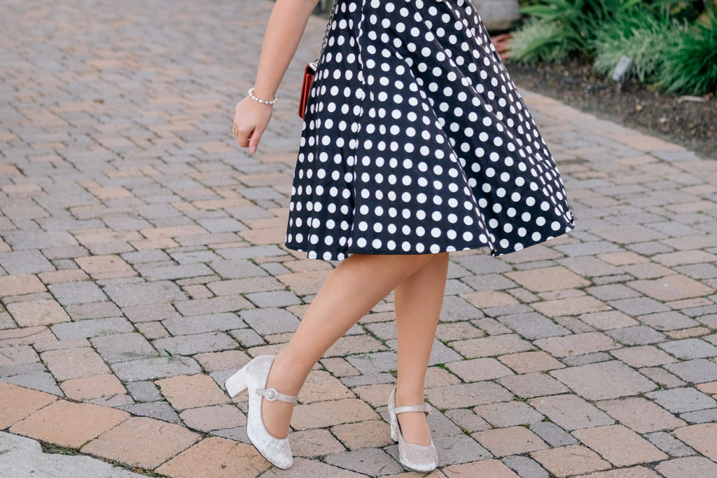 Debora Dahl wearing a polka dot dress and velvet shoes